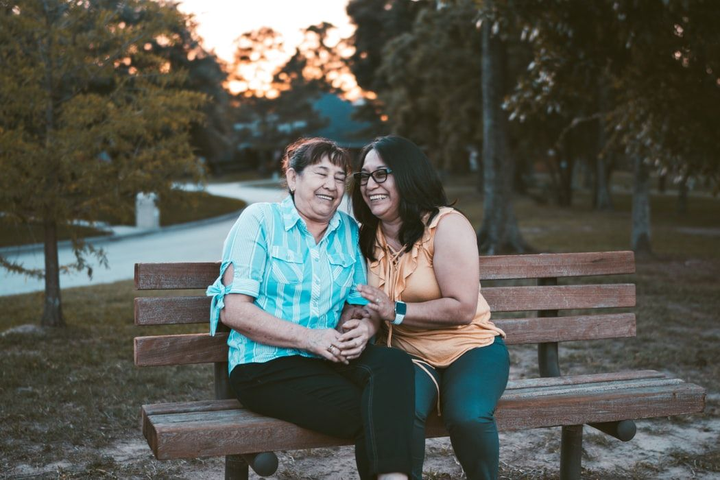 woman smiling on a bench with her mom