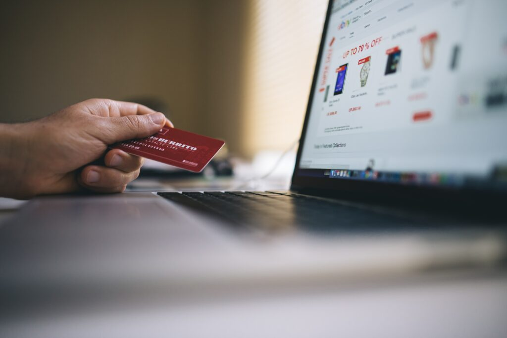 man entering credit card info into computer