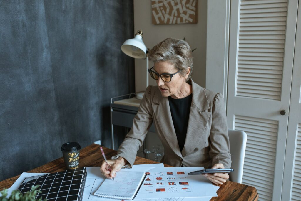 businesswoman calculating costs
